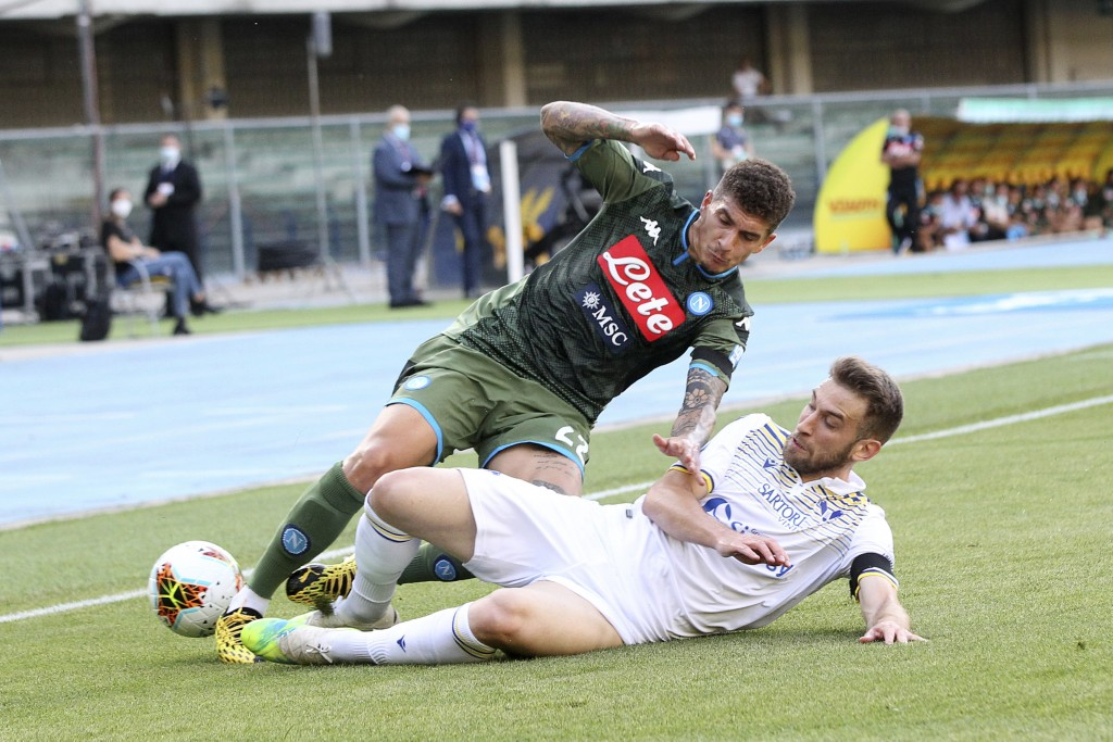 Napoli's Giovanni Di Lorenzo, left, is tackled by Hellas Verona's Alan Empereur, during the Serie A soccer match between Hellas Verona and Napoli at t...