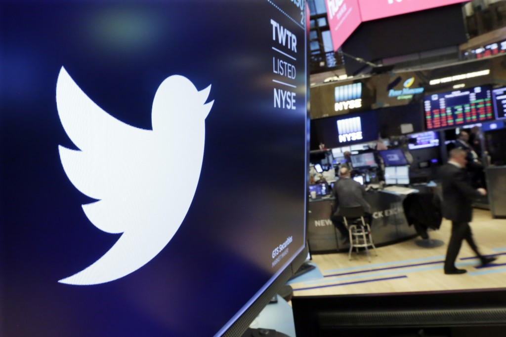 FILE - In this Feb. 8, 2018 file photo, the logo for Twitter is displayed above a trading post on the floor of the New York Stock Exchange.  Twitter s...