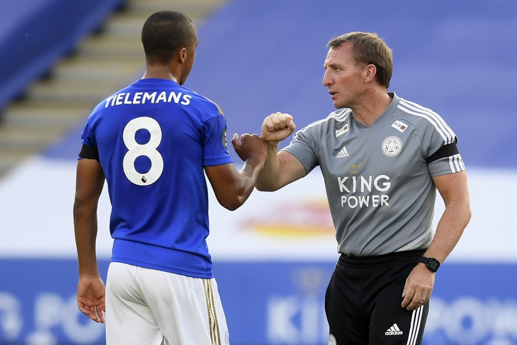 Leicester's manager Brendan Rodgers, right, congratulates his player Youri Tielemans during the English Premier League soccer match between Leicester ...