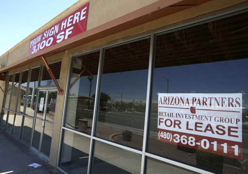 A business offers lease space available Sunday, June 21, 2020, in Phoenix.  Many businesses devastated by the coronavirus pandemic are expected to aba...