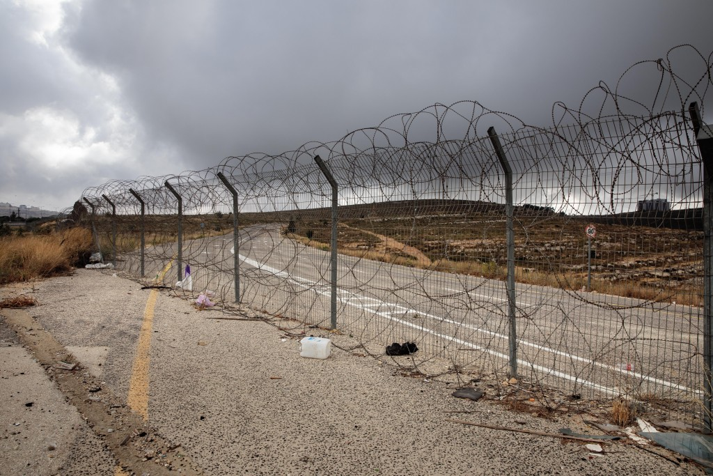 In this Friday, June 19, 2020 photo, a section of Israel's separation barrier blocks a road near the West Bank Jewish settlement of Beit Horon, Friday...