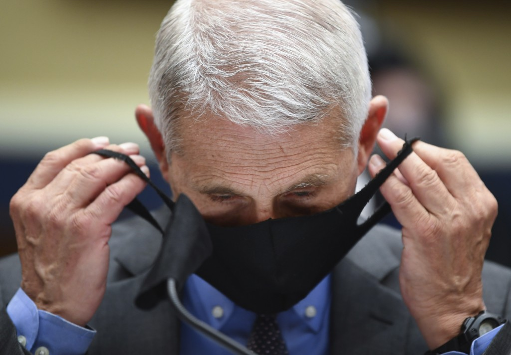 Director of the National Institute of Allergy and Infectious Diseases Dr. Anthony Faucitakes off his face mask before testifying before a House Commi...