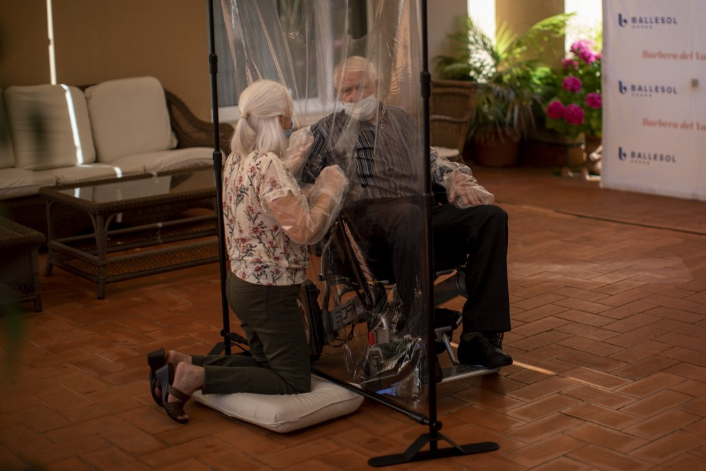In this Monday, June 22, 2020 photo, Dolores Reyes Fernández, 61, speaks with her father José Reyes Lozano, 87, for the first time in nearly four mont...
