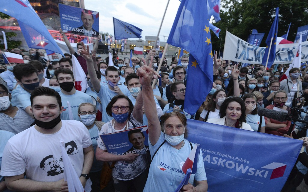 FILE - In this Wednesday, June 17, 2020 file photo, Supporters of presidential candidate Rafal Trzaskowski gather in front of Polish Television headqu...