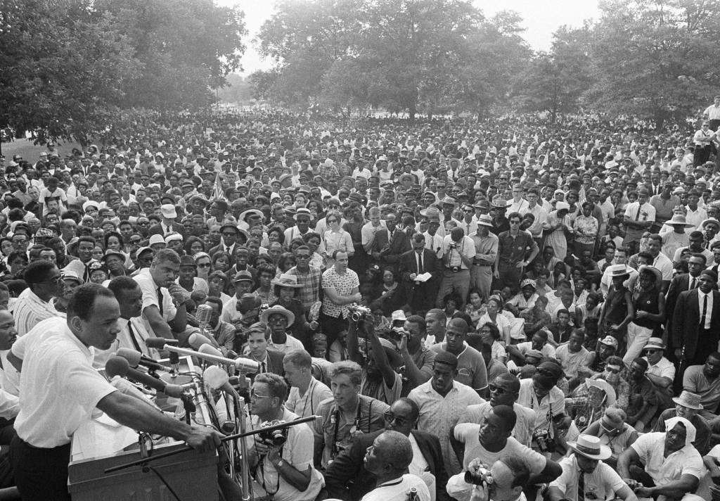 This June 26, 1966 file photo shows James Meredith, left, addressing a mass rally of civil rights demonstrators at the Mississippi State Capitol groun...