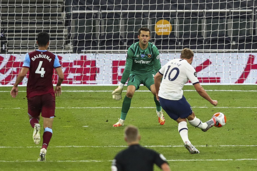 Tottenham's Harry Kane scores his team's second goal during the English Premier League soccer match between Tottenham Hotspur and West Ham at the Tott...