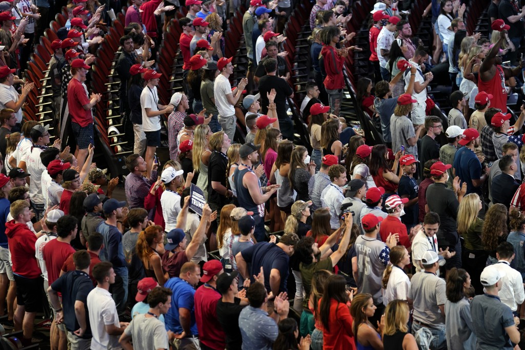 Supporters listen as President Donald Trump speaks to a group of young Republicans at Dream City Church, Tuesday, June 23, 2020, in Phoenix. (AP Photo...