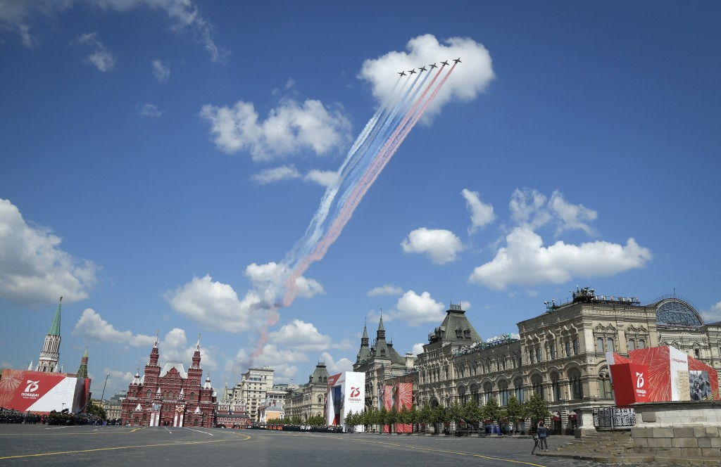 Russian warplanes fly over Red Square leaving trails of smoke in colors of national flag during the Victory Day military parade marking the 75th anniv...