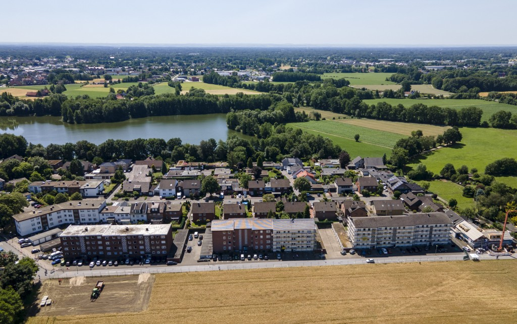 In this picture taken with a drone apartment buildings partly under quarntine due to a new coronavirus outbreak are seen in Verl, Germany, Wednesday, ...