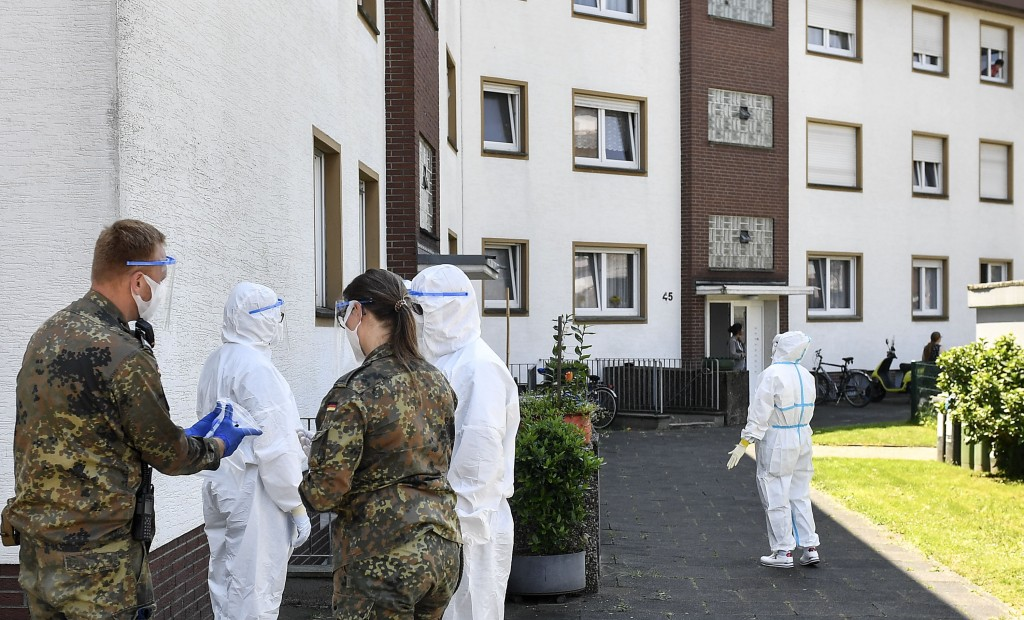 Medical staff and helpers from the German army take COVID-19 tests of Toennies employees and their families who are quarantined in Verl, Germany, Tues...