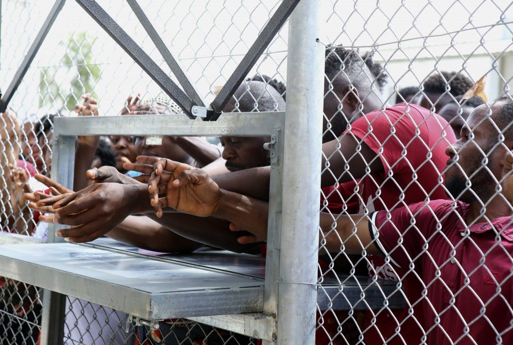 Migrants wait for food inside a refugee camp in Kokkinotrimithia outside of Nicosia, Cyprus, on Tuesday, June 23, 2020. Cyprus' interior minister says...