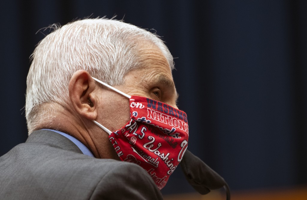 Director of the National Institute of Allergy and Infectious Diseases Dr. Anthony Fauci wears a face mask and listens during a House Committee on Ener...