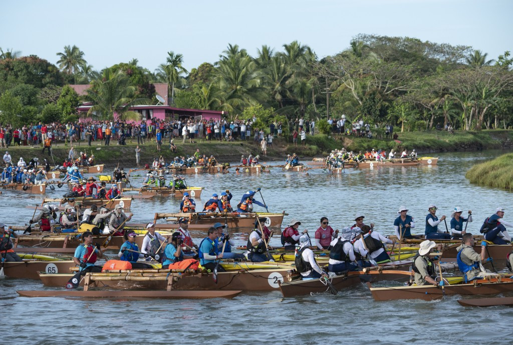 In this image released by Amazon, racers compete in the 2019 Eco-Challenge adventure race in Fiji. The competition's new 10-episode season, hosted by ...