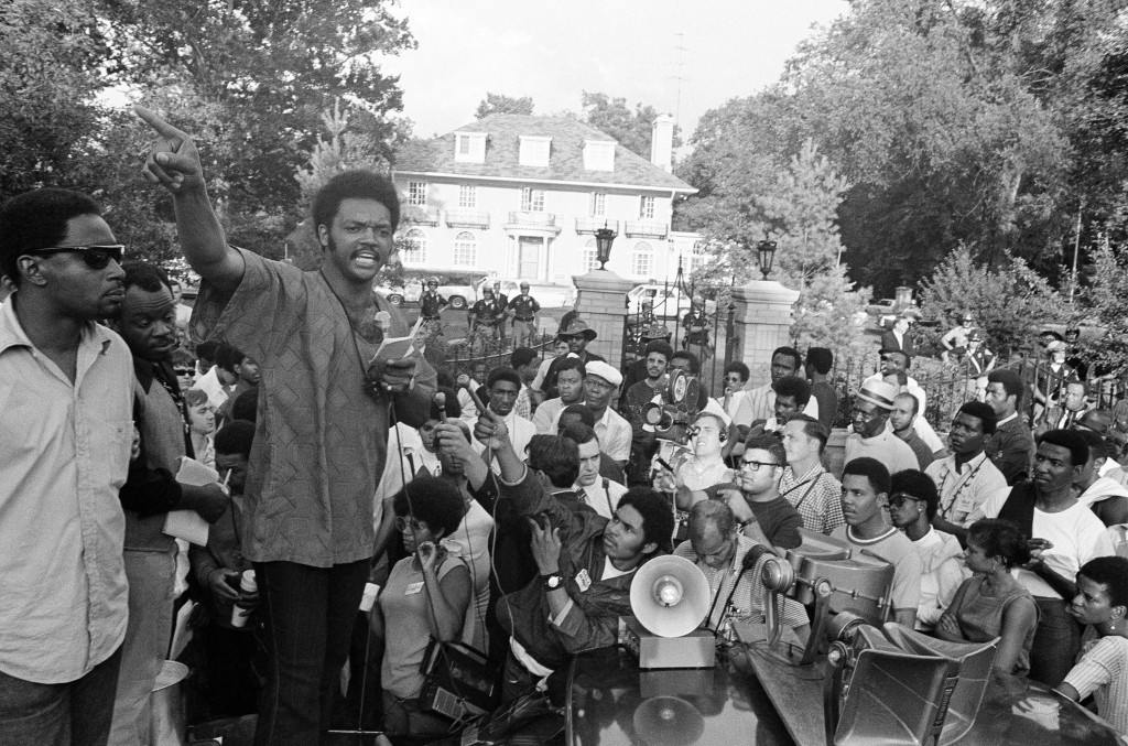 This July 27, 1969 fie photo shows Rev. Jesse Jackson speaking to a protest group in front of the Indiana Governor's mansion in Indianapolis. Today's ...