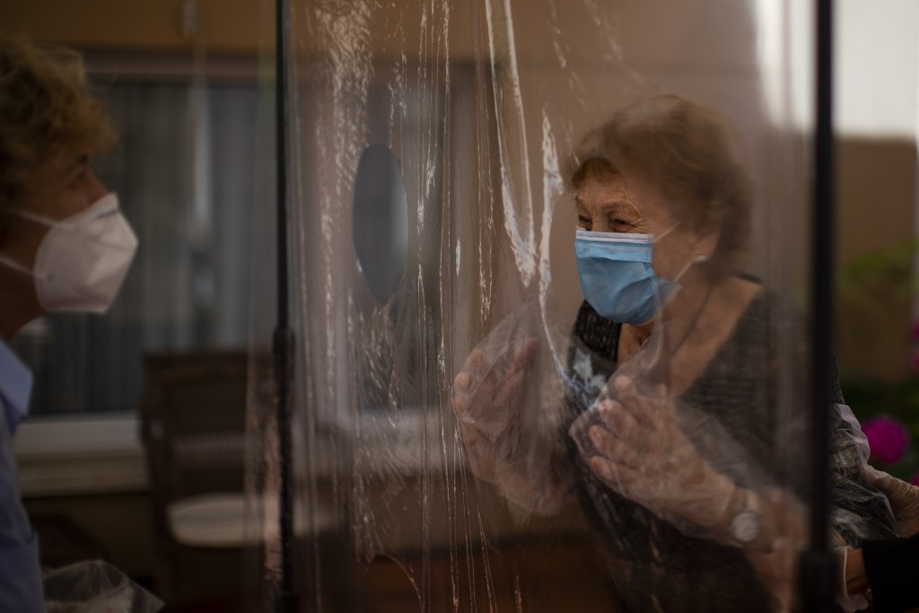 In this Monday, June 22, 2020 photo and in their first encounter in more than 100 days due to restrictions to fight the coronavirus pandemic, Isabel P...