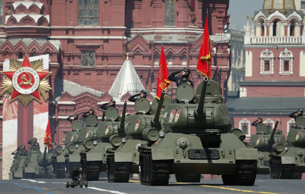 Soviet tanks T-34 roll toward Red Square during the Victory Day military parade marking the 75th anniversary of the Nazi defeat in Moscow, Russia, Wed...