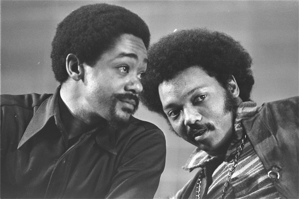 This Saturday, March 12, 1972 fie photo shows Bobby Seale, left, and the Rev. Jesse Jackson talking at the National Black Political Convention in Gary...