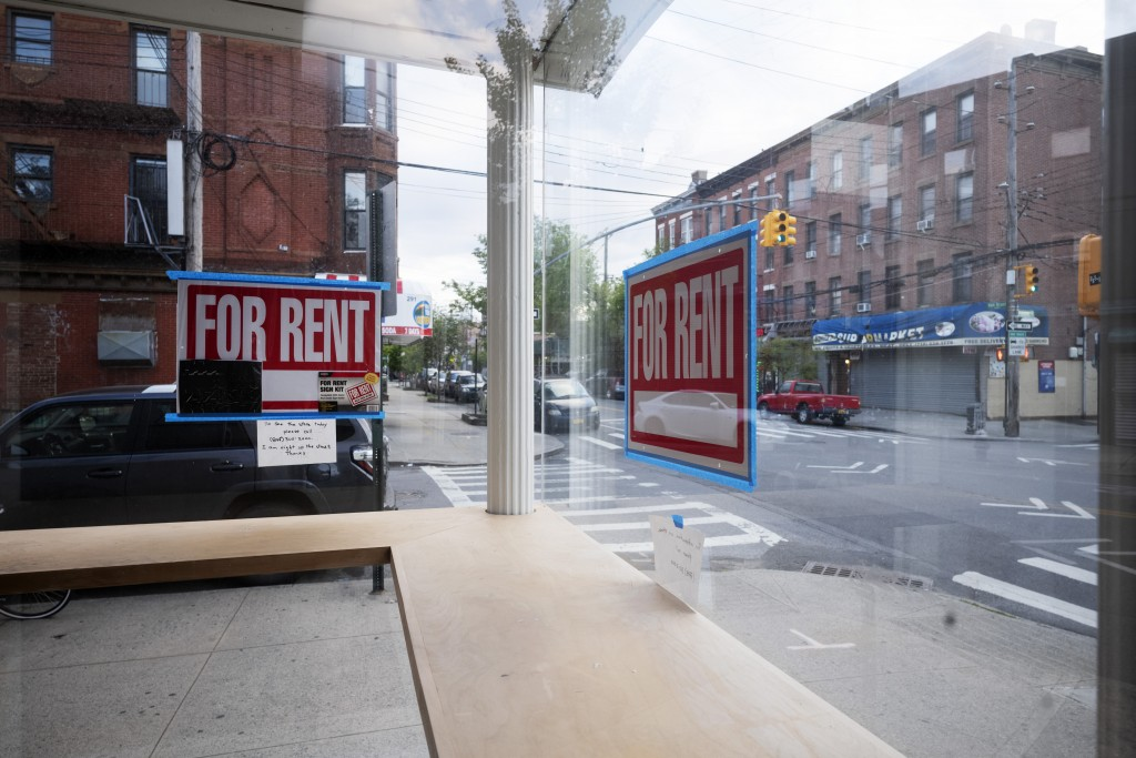 """In this May 12, 2020 photo, a storefront displays """"For Rent"""" signs in the window in the Red Hook neighborhood of the Brooklyn borough of New York. . S..."""