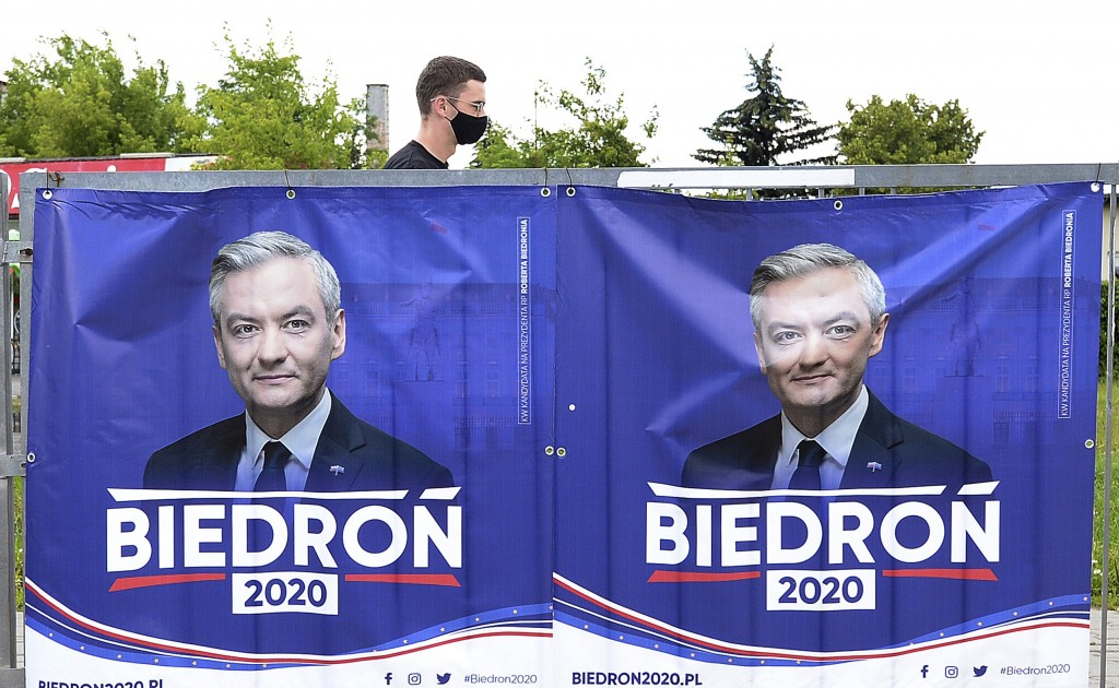 An electoral poster for left-wing candidate Robert Biedron is seen, in Warsaw, Poland, Tuesday, June 23, 2020. Biedron, who is openly gay, is currentl...
