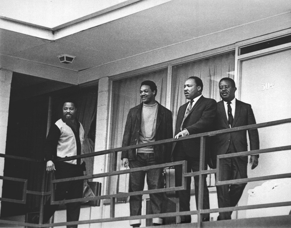 This April 3, 1968 file photo shows Rev. Martin Luther King Jr., second from right, standing with other civil rights leaders on the balcony of the Lor...