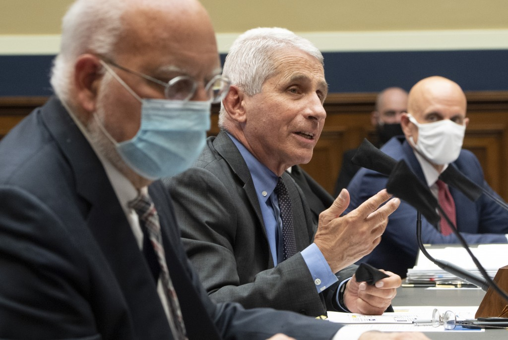 From left to right, Dr. Robert Redfield, Director, Centers for Disease Control and Prevention; Dr. Anthony Fauci, Director, National Institute for All...