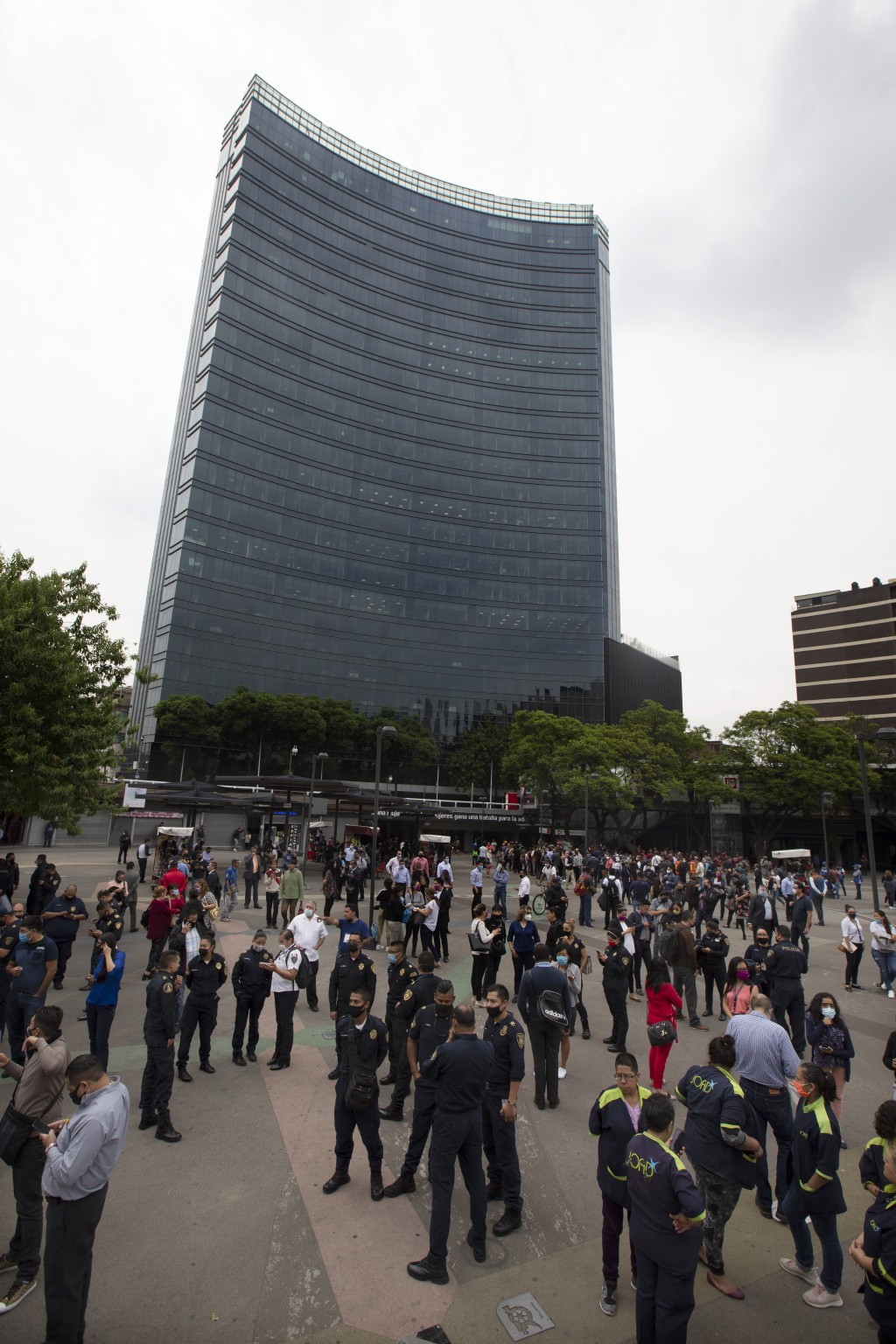 Residents stand in the pedestrian walkway of the Insurgentes roundabout after an earthquake in Mexico City on Tuesday, June 23, 2020. The earthquake s...