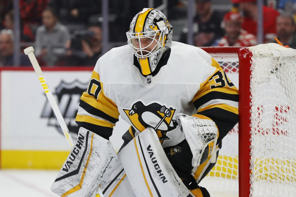 FILE - In this Jan. 17, 2020, file photo, Pittsburgh Penguins goaltender Matt Murray plays against the Detroit Red Wings in the second period of an NH...