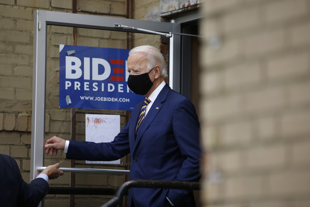 Democratic presidential candidate, former Vice President Joe Biden arrives at Carlette's Hideaway, a soul food restaurant, to speak with small busines...