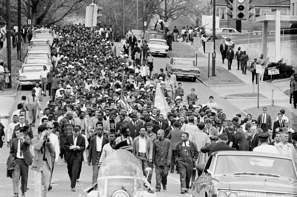 FILE - In this March 17, 1965, file photo, demonstrators walk to the courthouse behind the Rev. Martin Luther King Jr. in Montgomery, Ala. The march w...