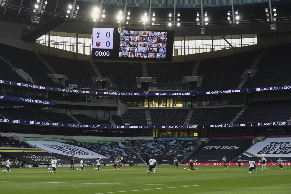 Players take a knee prior the English Premier League soccer match between Tottenham Hotspur and West Ham at the Tottenham Hotspur stadium in London, E...
