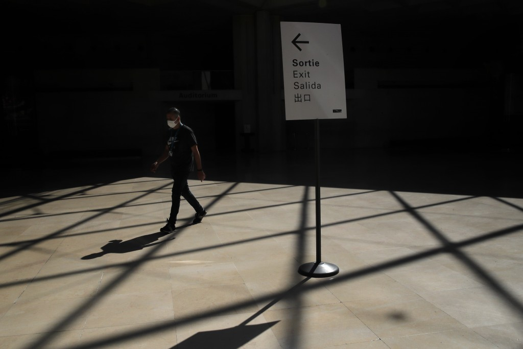 A worker walks during a visit of the Louvre museum as part of its reopening next July 6, in Paris, Tuesday, June 23, 2020. After four months of virus-...