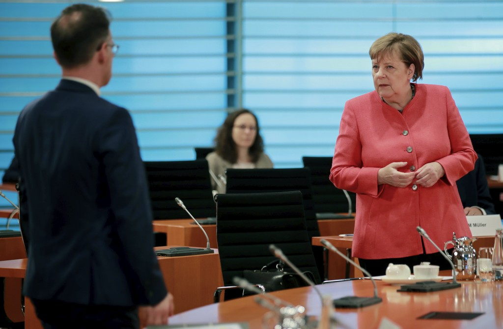 German Chancellor Angela Merkel, right, and German Foreign Minister Heiko Maas, right, attend the weekly cabinet meeting at the chancellery in Berlin,...