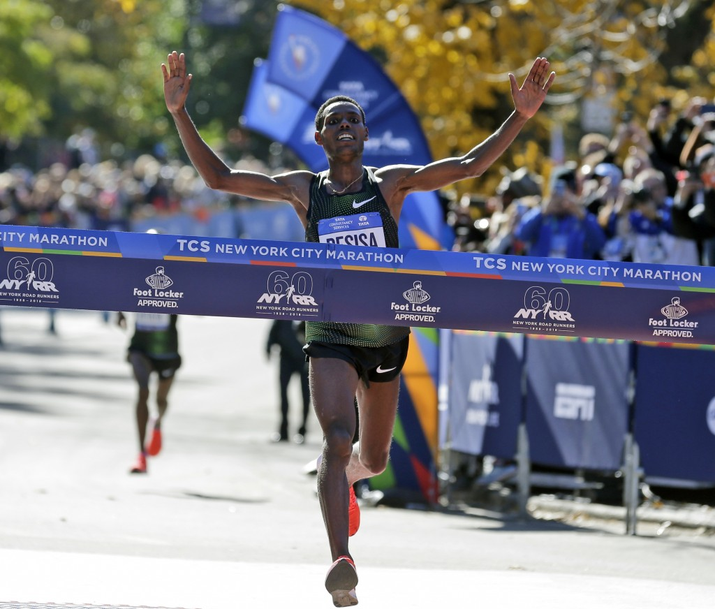 FILE - In this Nov. 4, 2018, file photo, Lelisa Desisa, of Ethiopia, crosses the finish line first in the men's division of the New York City Marathon...