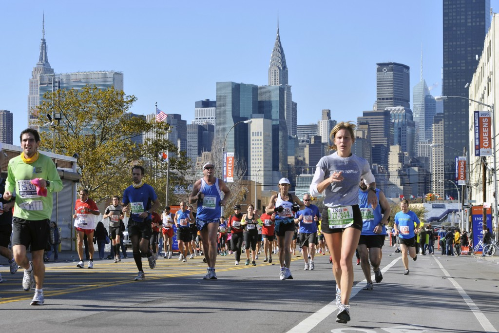 FILE - In this Nov. 6, 2011, file photo, runners make their way down 44th Drive in the Queens borough of New York during the New York City Marathon. T...