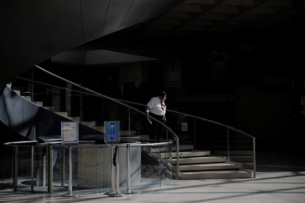 A guards steps down the stairs during a visit of the Louvre museum ahead of its reopening next July 6, in Paris, Tuesday, June 23, 2020. Before mass t...