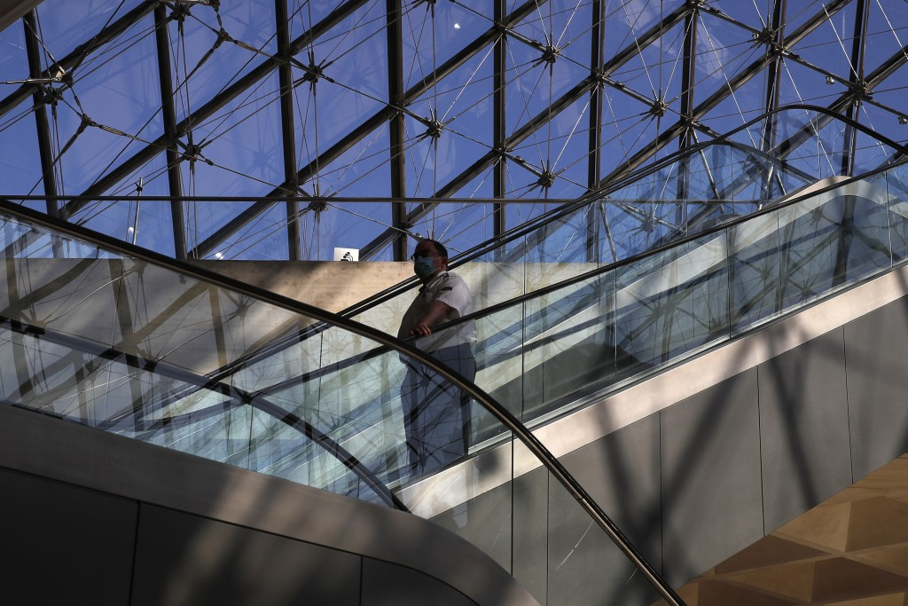 A guard goes down the stairs during a visit of the Louvre museum as part of its reopening next July 6, in Paris, Tuesday, June 23, 2020. After four mo...