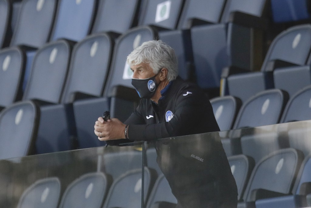 Atalanta's head coach Gian Piero Gasperini follows the game from the stands after getting a red card during the Serie A soccer match between Atalanta ...
