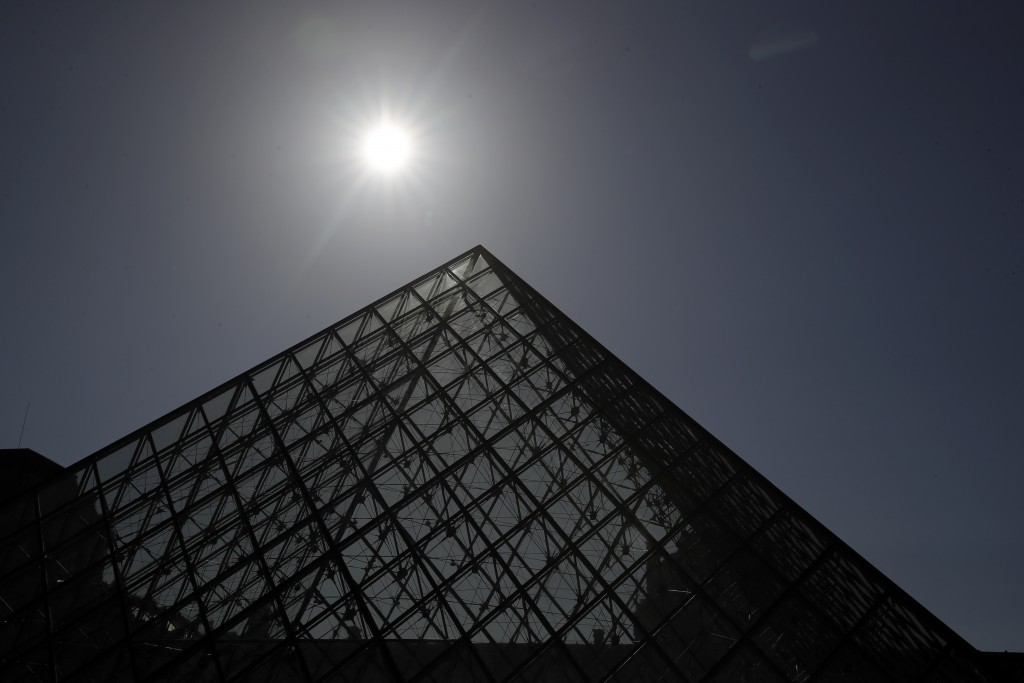 The pyramid of the Louvre museum is pictured before a visit ahead of its reopening next July 6, in Paris, Tuesday, June 23, 2020. Before mass tourism ...