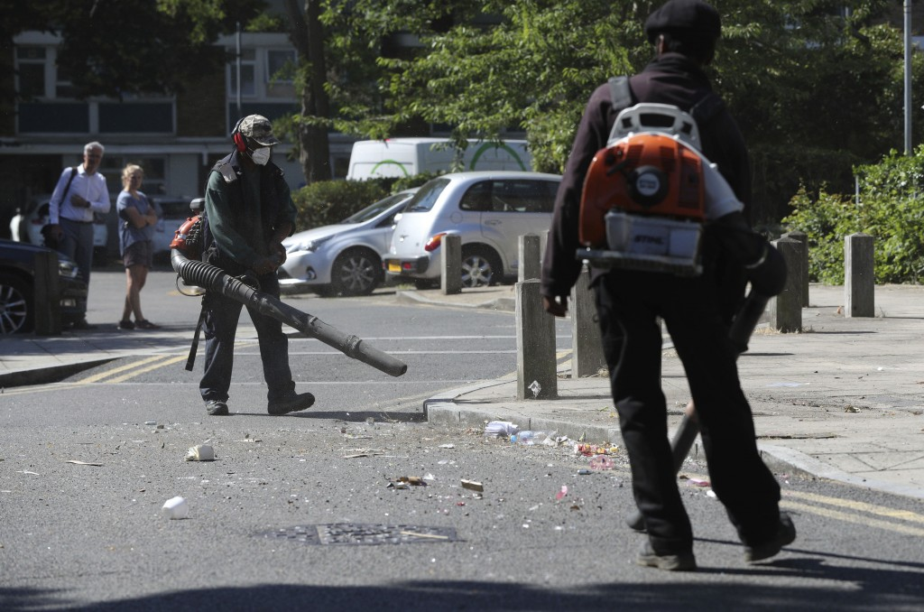 Volunteers clean up following violent confrontations with police took place overnight, in the Brixton area of London,  Thursday June 25, 2020.  Author...