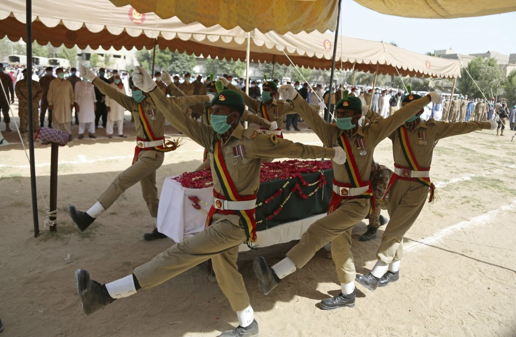 Pakistani soldiers attend the funeral of their colleague who died in the crash of a state-run Pakistan International Airlines plane on May 22, in Kara...