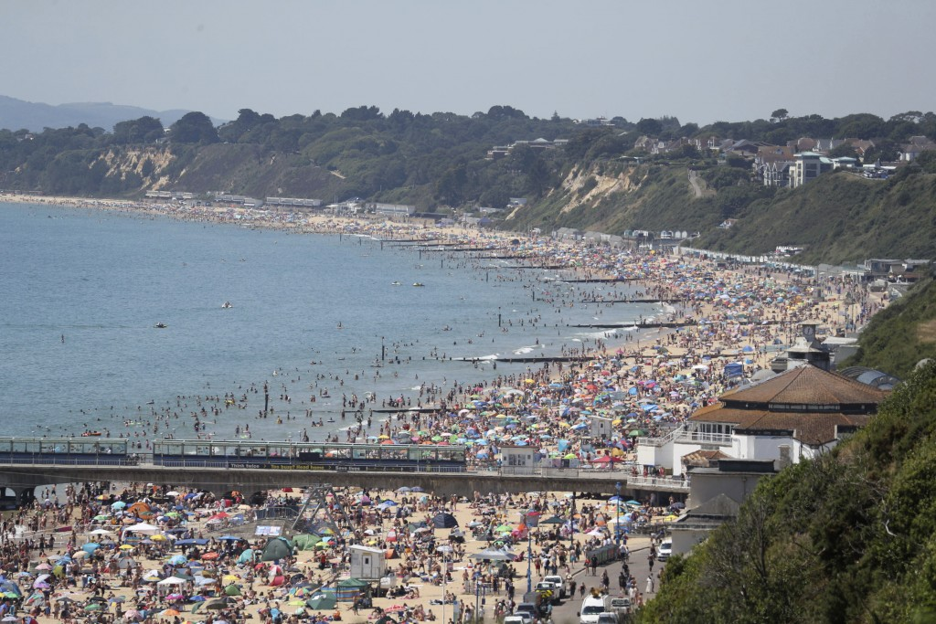 Crowds gather as hot weather draws crowds to the beach in Bournemouth, England, Thursday June 25, 2020. Coronavirus lockdown restrictions are being re...