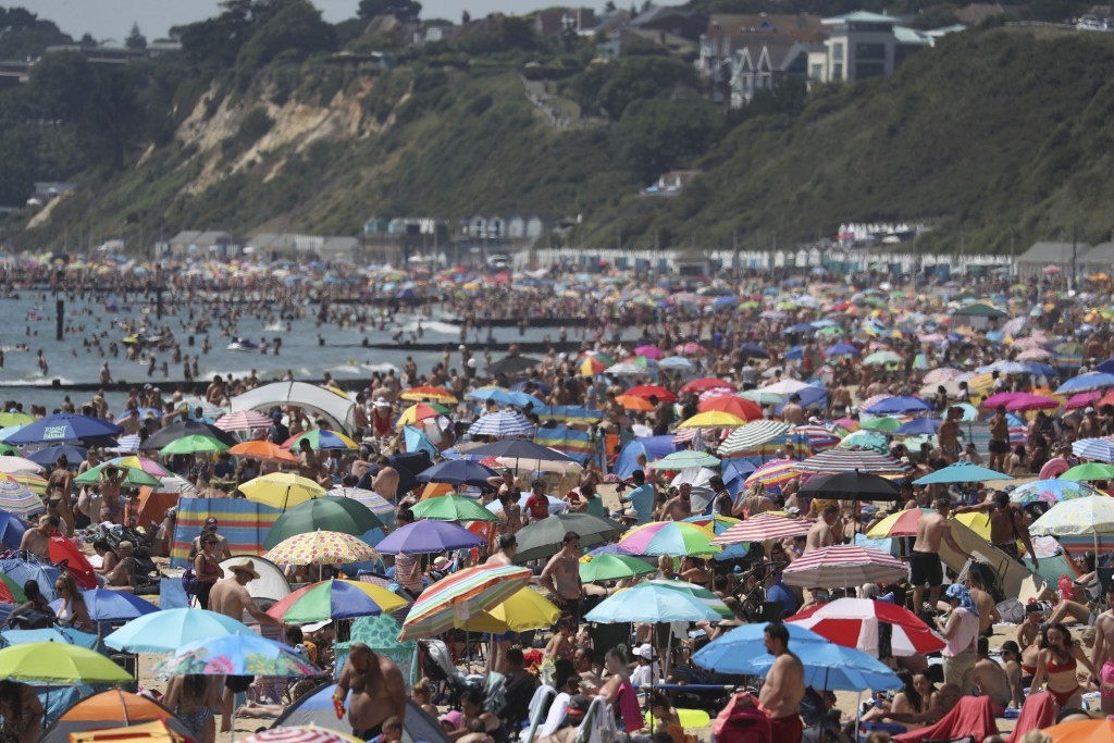 Crowds gather on the beach in Bournemouth as the UK experience a heat wave, in Bournemouth, England, Thursday, June 25, 2020. (Andrew Matthews/PA via ...