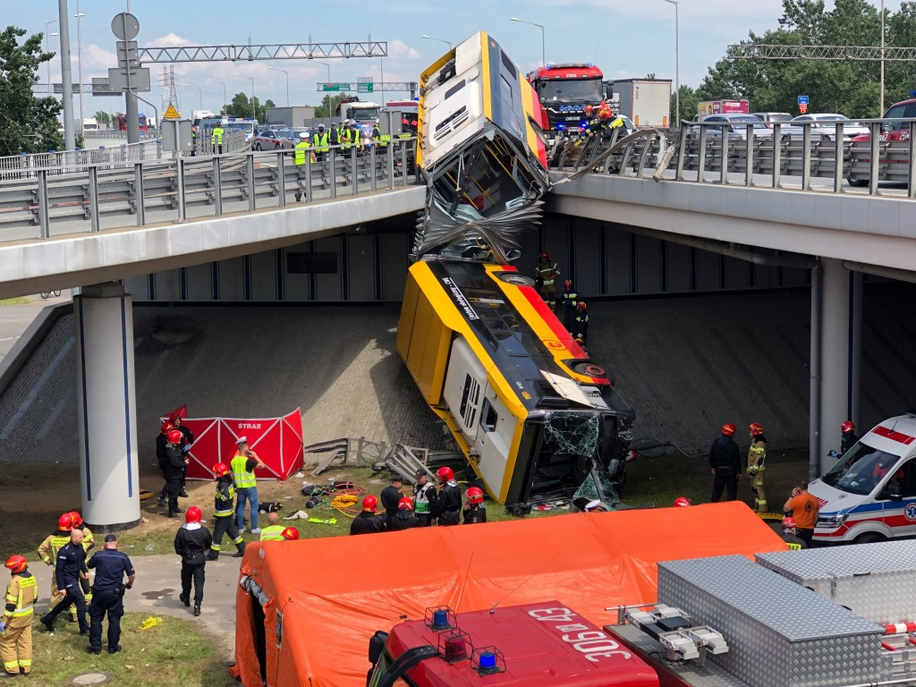 A view of  Warsaw city bus after it crashed off an overpass, in Warsaw, Poland, Thursday, June 25, 2020. The bus crashed through a barrier on a highwa...