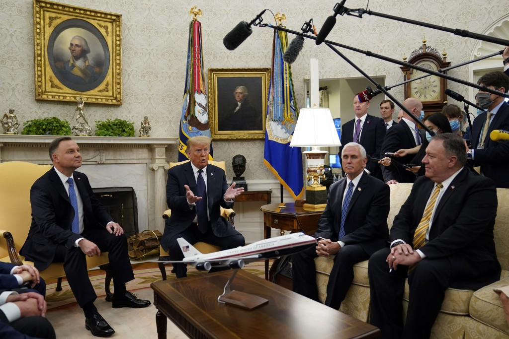 President Donald Trump meets with Polish President Andrzej Duda in the Oval Office of the White House, Wednesday, June 24, 2020, in Washington, as Vic...
