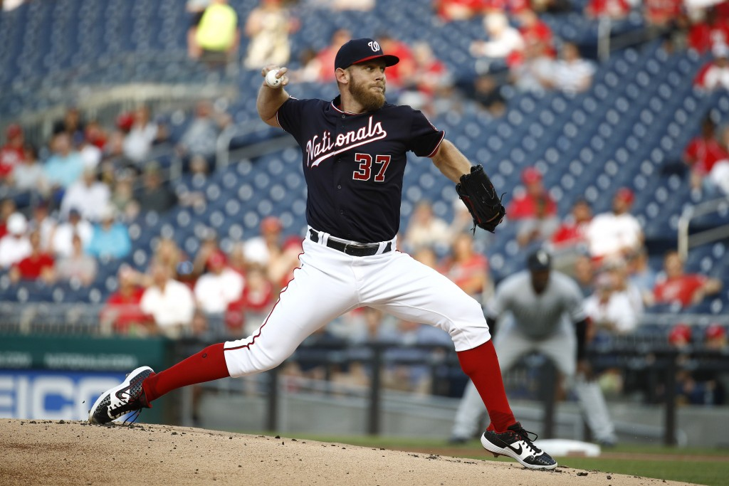 FILE - In this June 4, 2019, file photo, Washington Nationals starting pitcher Stephen Strasburg throws to the Chicago White Sox in the first inning o...