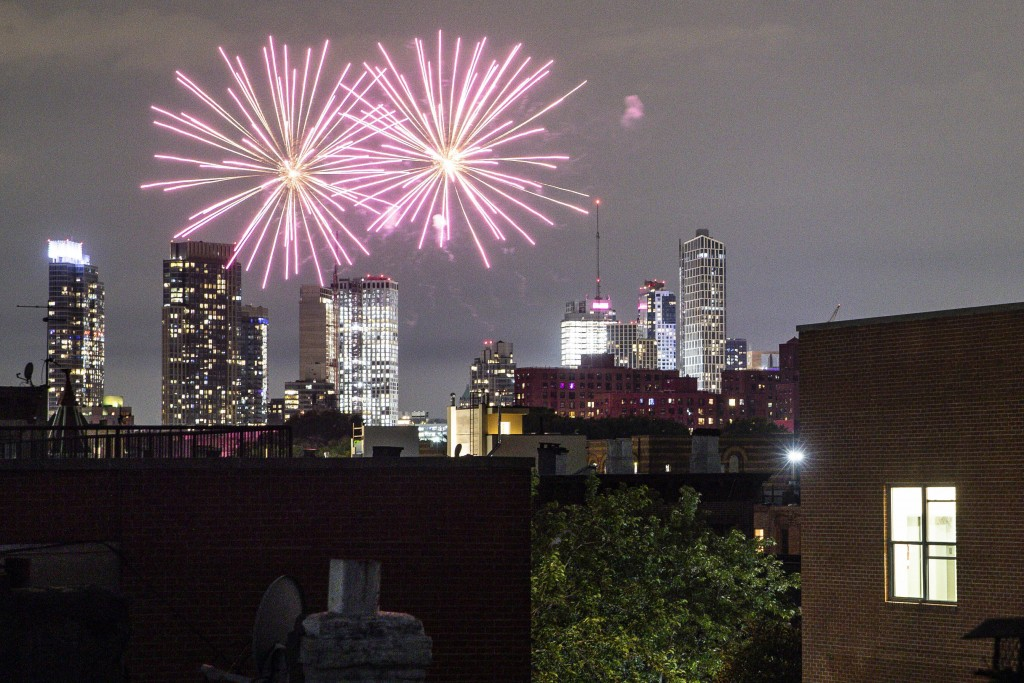 FILE - In this Friday, June 19, 2020 photo, fireworks explode during Juneteenth celebrations above the Bedford-Stuyvesant neighborhood in the Brooklyn...