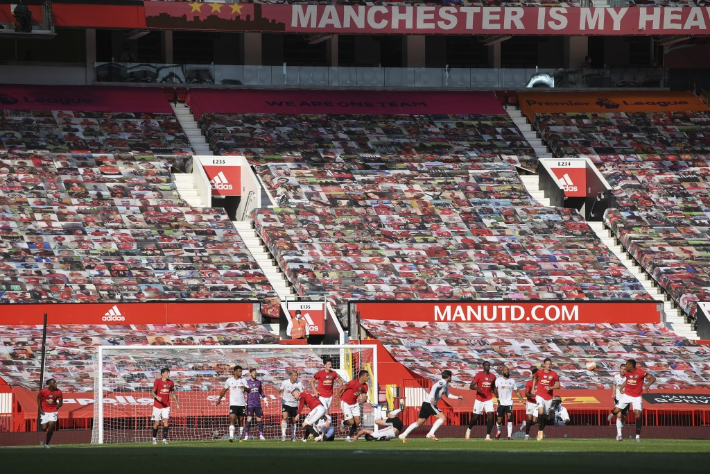 Manchester United's Anthony Martial, right, passes the ball during the English Premier League soccer match between Manchester United and Sheffield Uni...