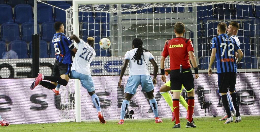Atalanta's Jose Luis Palomino, left, scores a goal during a Serie A soccer match between Atalanta and Lazio, at the Gewiss Stadium in Bergamo, Italy, ...