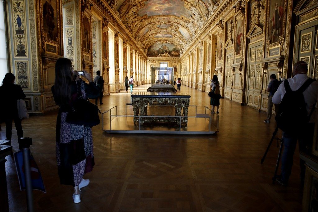 Journalists take picture of the Galerie d'Apollon during a visit of the Louvre museum ahead of its reopening next July 6, in Paris, Tuesday, June 23, ...