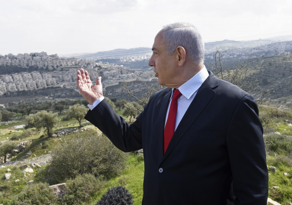FILE - In this Feb. 20, 2020 file photo, Israeli Prime Minister Benjamin Netanyahu visits the area where a new neighborhood is to be built in the East...